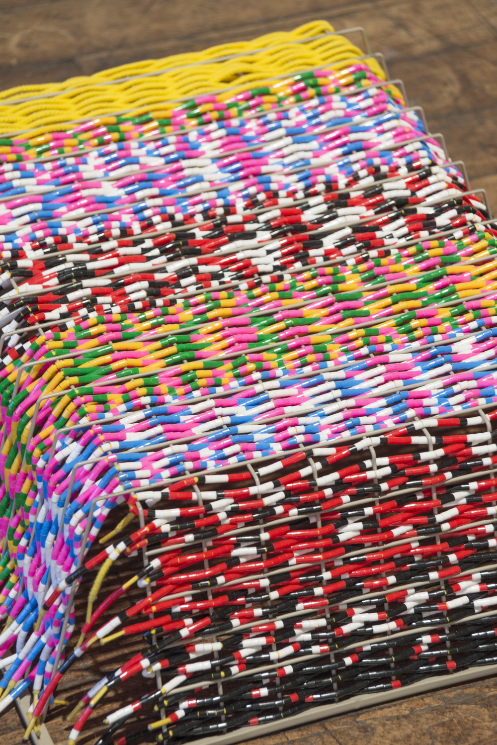 (detail), 2016, Metal basket, shoelaces and plastic beads