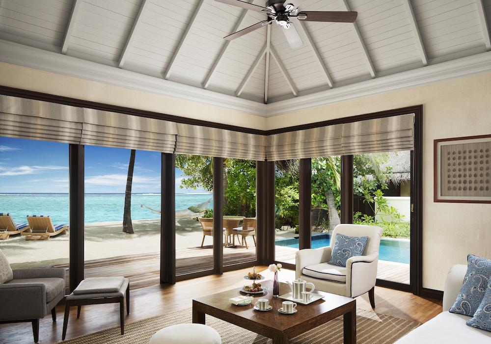 54633587-H1-One_Bedroom_Beach_Villa_Suite_with_Pool_-_Living_Room.jpg