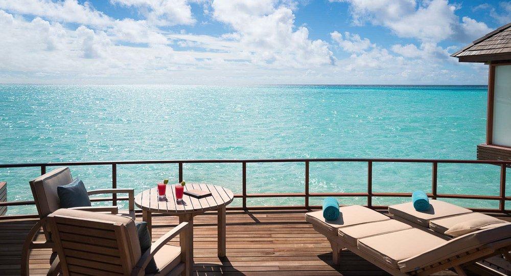 anantara_dhigu_maldives_sunset_over_water_suite_deck_01_1920x1037.jpg