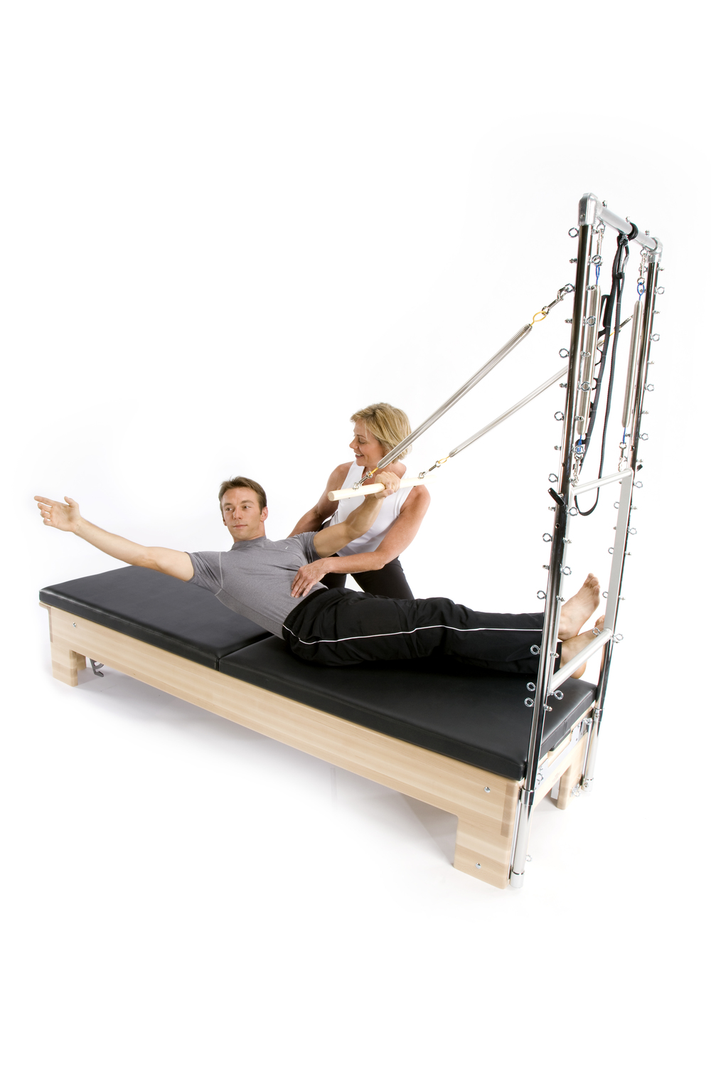 Reformer/Tower Combo Roll Down Water Skier exercise.