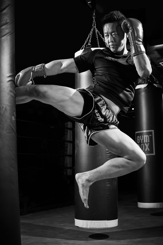 Sports & Fitness Commercial Portraits Gym Box Personal Trainers Flying Kick Muai Thai