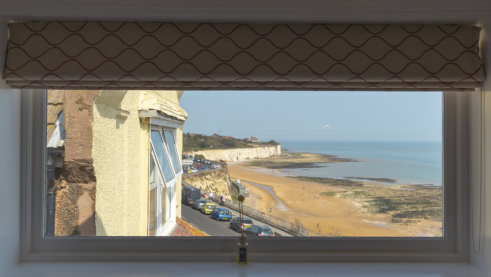 Picture window view over Stone Bay.