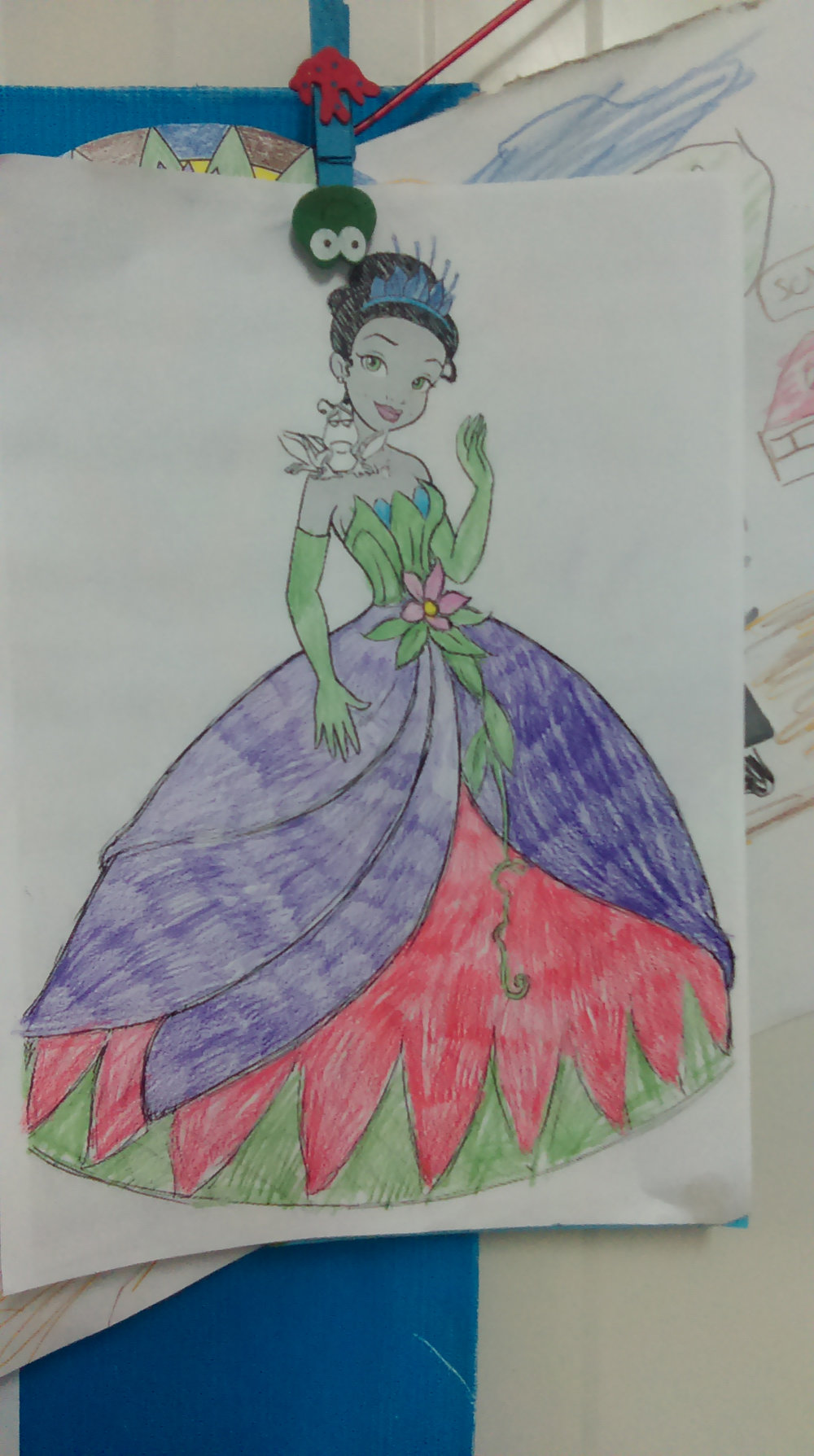 Rasha's coloring page of a princess. Part of the image, upper left corner of the drawing, was changed for privacy reasons.