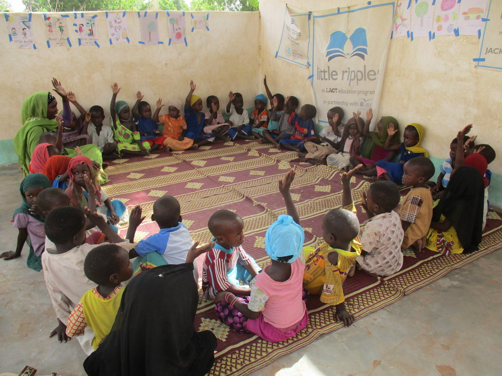 Circle time at a Little Ripples in-home center in eastern Chad. iACT:2017.JPG