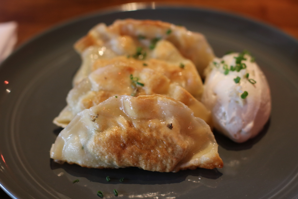 Pierogie    Roasted potato and duck confit, whipped horseradish buttermilk
