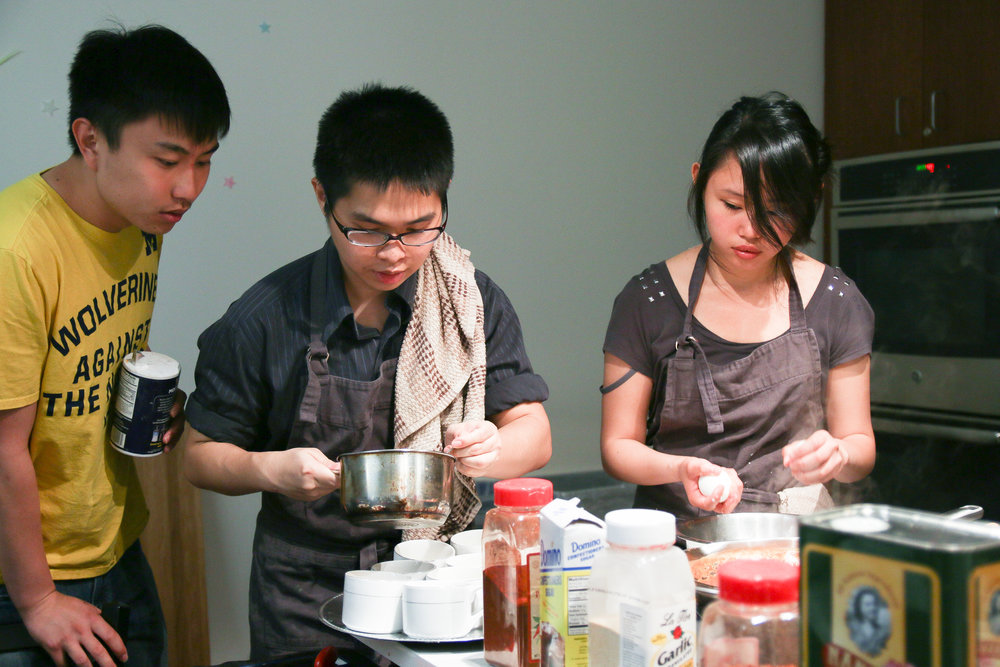 Members of Cookology, an on-campus student cooking group, prepare dishes for a recent Midnight Dinner.