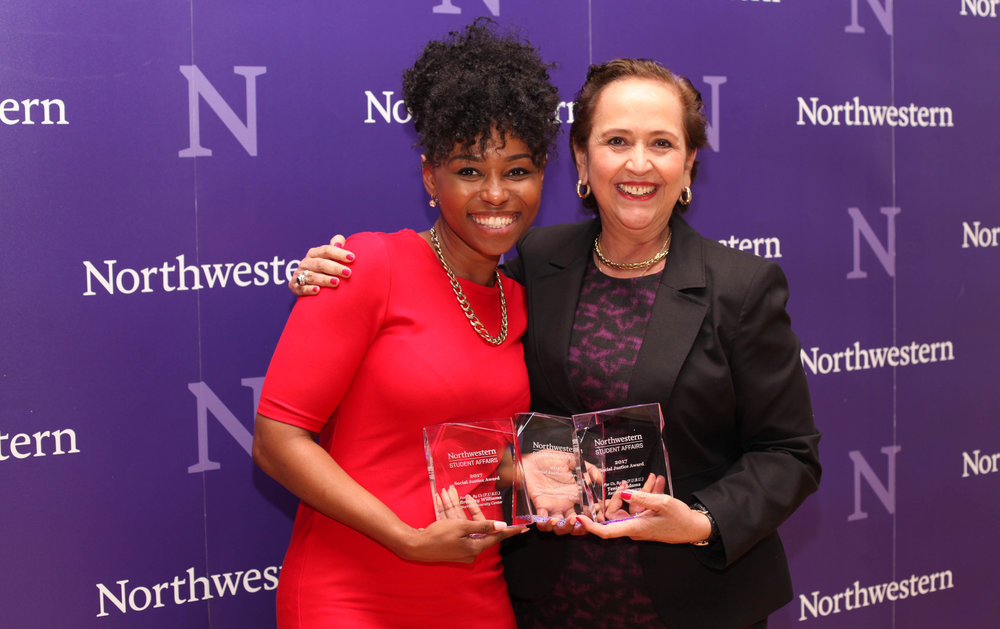 Brittany Williams accepts the Social Justice Award from Vice President for Student Affairs Patricia Telles-Irvin for the For Us, By Us (F.U.B.U) team.