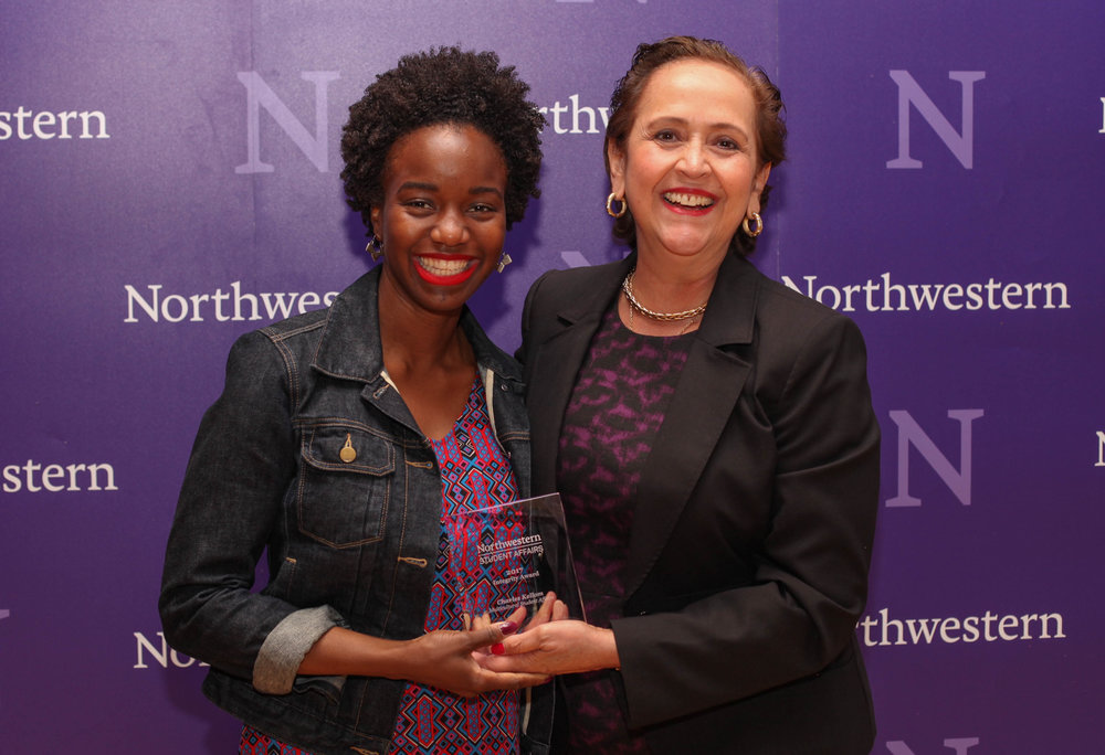 Lesley-Ann Brown-Henderson accepts the Integrity Award on behalf of Charles Kellom of Multicultural Student Affairs.