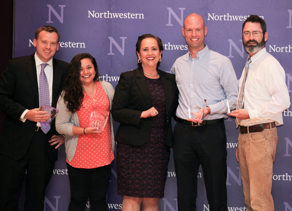 Luka Figora, Nancy Cambron Perez, James McHaley and Dan Foley accept the Collaborative Excellence Award from Vice President for Student Affairs Patricia Telles-Irvin.