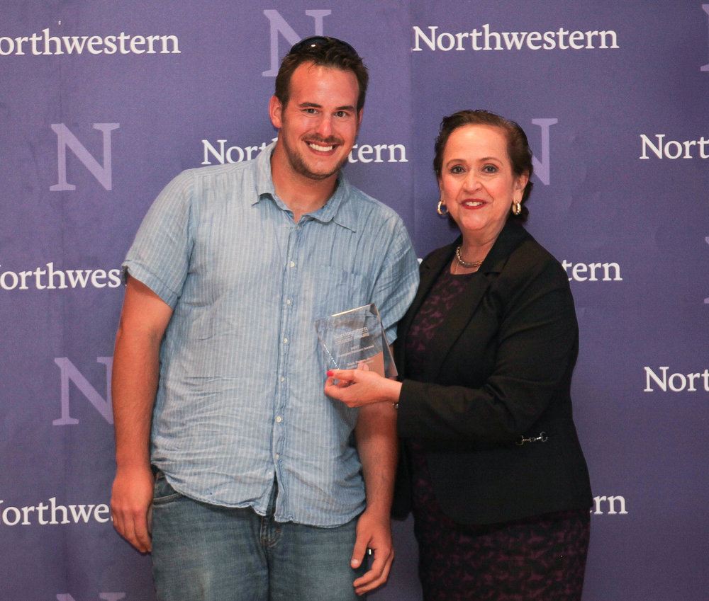 Nick Papas Jr. of Facilities Management accepts the Campus Partner Award from Vice President for Student Affairs Patricia Telles-Irvin.