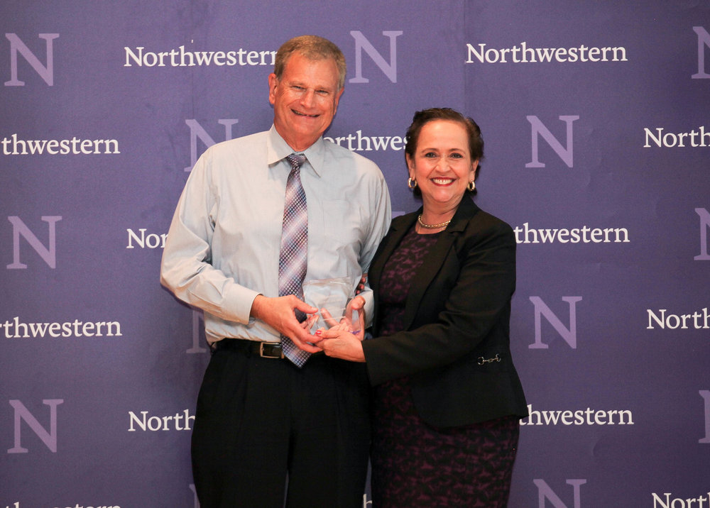 Ronald Braeutigam of the Office of the Provost accepts the Campus Partner Award for the International Office from Vice President for Student Affairs Patricia Telles-Irvin.