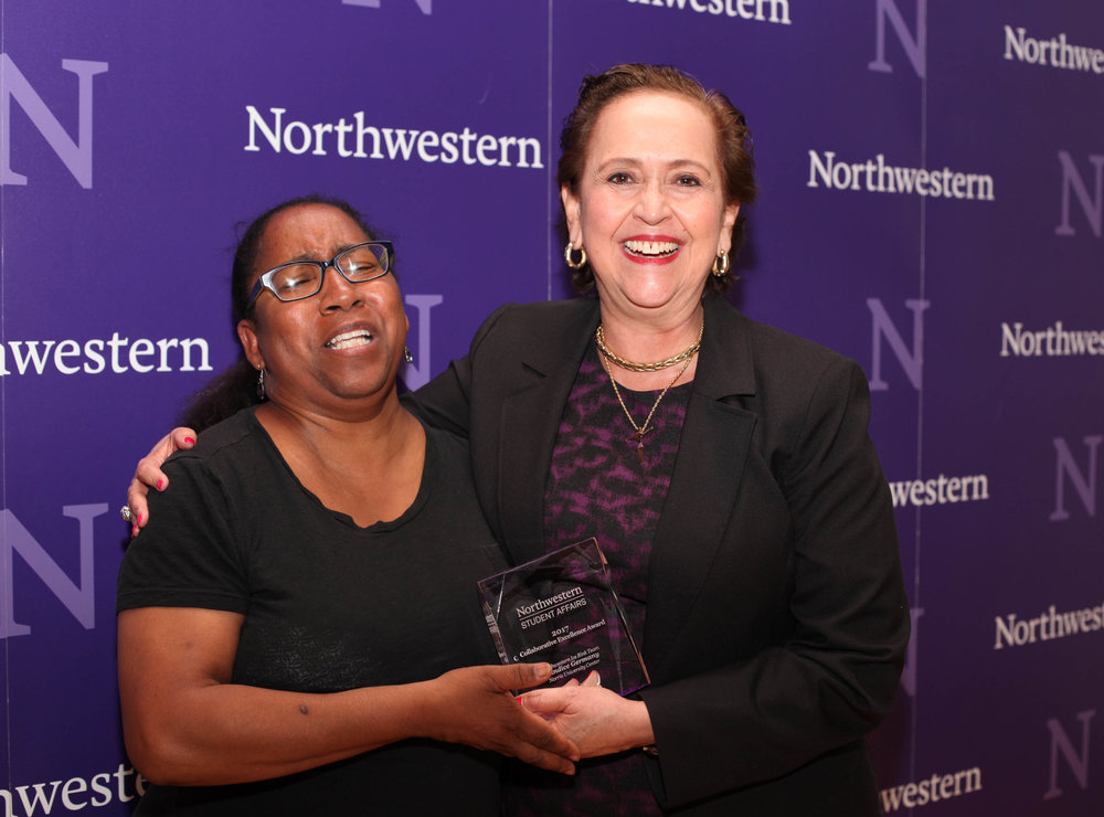 Tracie Thomas of Northwestern Career Advancement accepts the Distinguished Service Award from Vice President for Student Affairs Patricia Telles-Irvin.