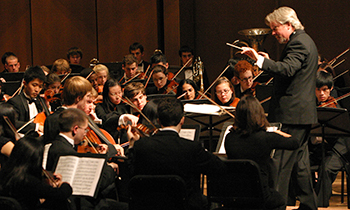 The Philharmonia orchestra performing in concert