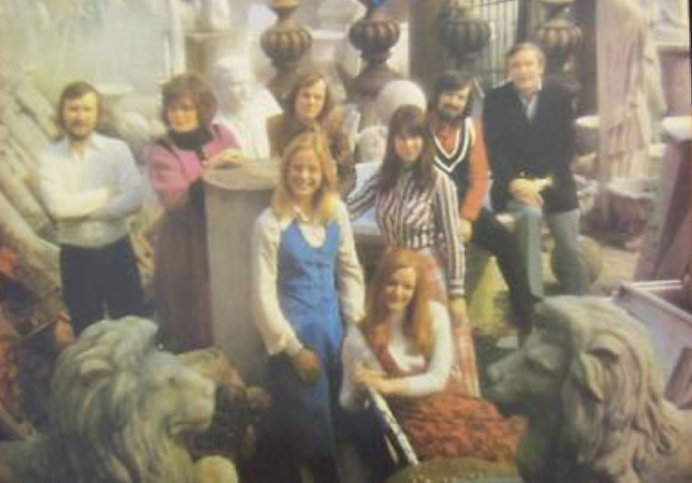 "The first English group poses for a photo used for the UK release ""Madrigals"". Back, L-R: David Beavan, Linda Hirst, John Lubbock, John Potter, Ward Swingle. Front, Carol Hall, Olive Simpson (seated), Mary Beverly."