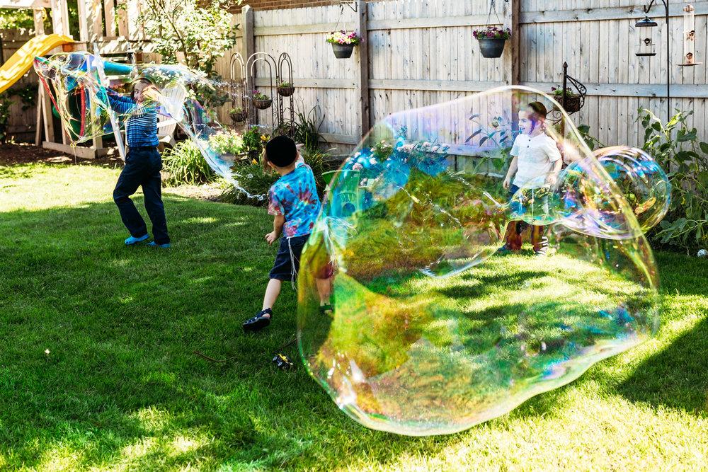 kids-playing-backyard-bubbles-milwaukee.jpg