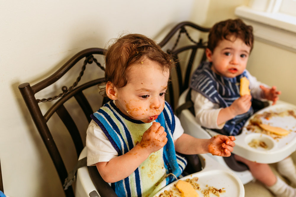 toddlers eating dinner with messy faces in Milwaukee