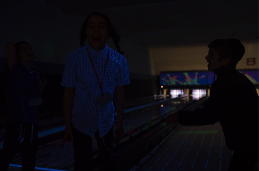 Before image of 3 boys at the bowling alley