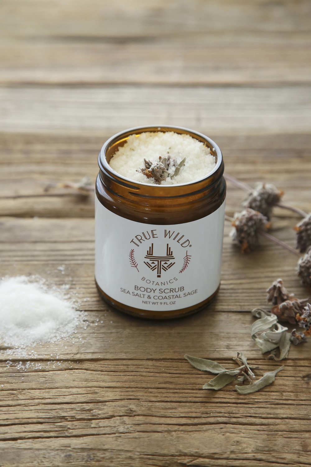 True Wild Botanics Sea Salt & Coastal Sage Body Scrub  incorporates California native sages with mineral-packed Dead Sea salts to detoxify, nourish, and restore balance to the skin. These powerful healing agents are combined for a simple way to replenish, exfoliate, and rejuvenate skin.