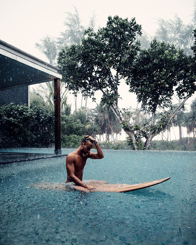 Ran down from the beach to our pool at @bababeachclub.phuket after a fun little surf session in the rain. We did nothing that evening except listen to the distant thunderstorms and talk about life as the sun set. ✨