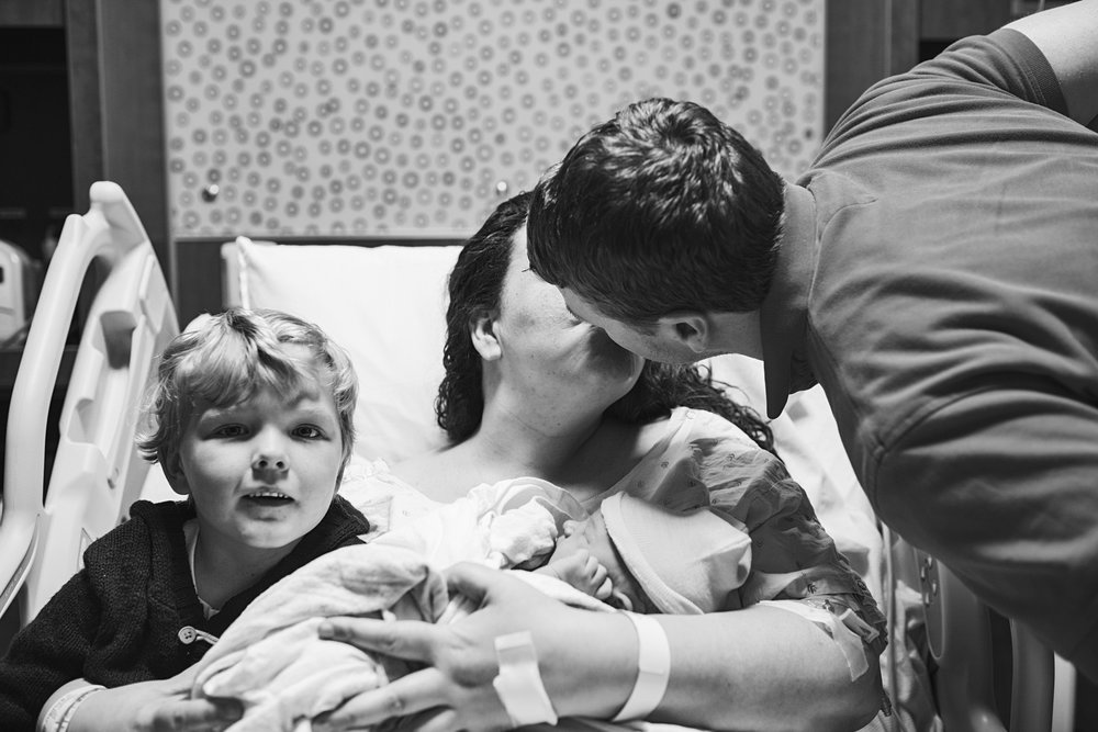 Family together after a c-section delivery - Richmond Hospital Birth Photographer