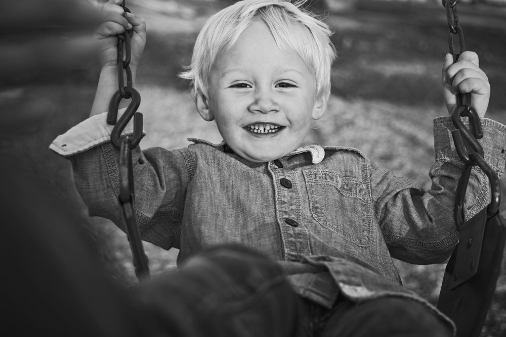 Family photography is all about adventure, which includes kids at home or in a park like Manhattan City Park or Wamego swinging.