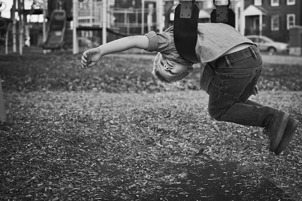 Playing on the swings is a great kid activity to photograph during your MHK family photography session.