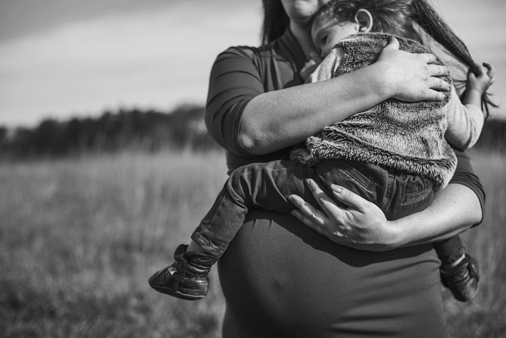 Documentary maternity session takes place in central Virginia to share the growth of family.