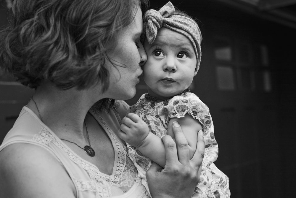 Richmond family photographer creates portrait of a mother and her daughter outside their RVA home.