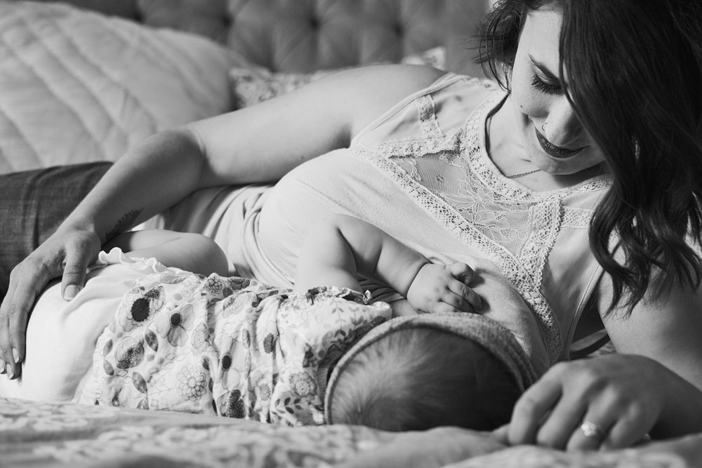 Timeless black and white breastfeeding portrait of mother and daughter in their downtown Richmond home.