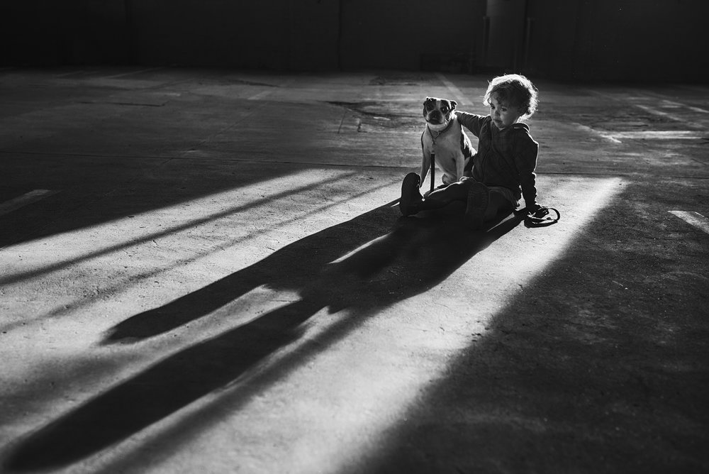 A quite moment photographed of a girl and her dog at home in her downtown RVA apartment.