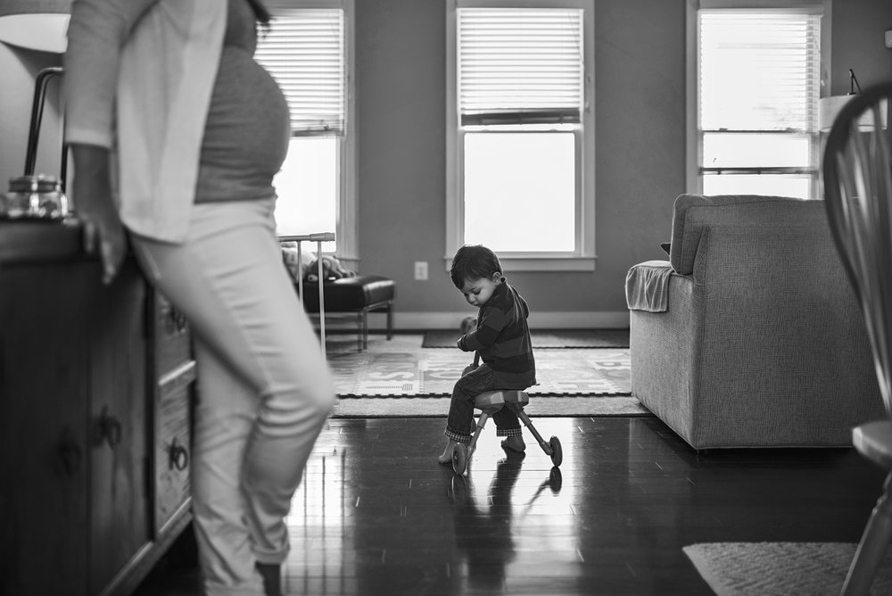 In home documentary maternity session shows the connection between older siblings and the growing family in and around Richmond, Virginia.