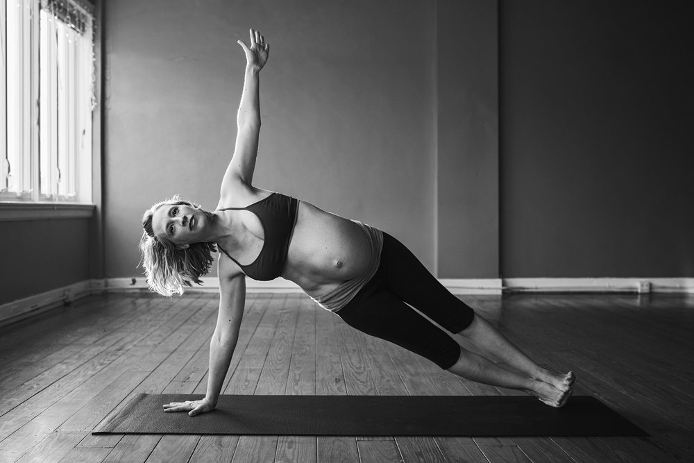 Richmond photographer creates images of a maternity yoga instructor as she flows during her photography session in Carytown.
