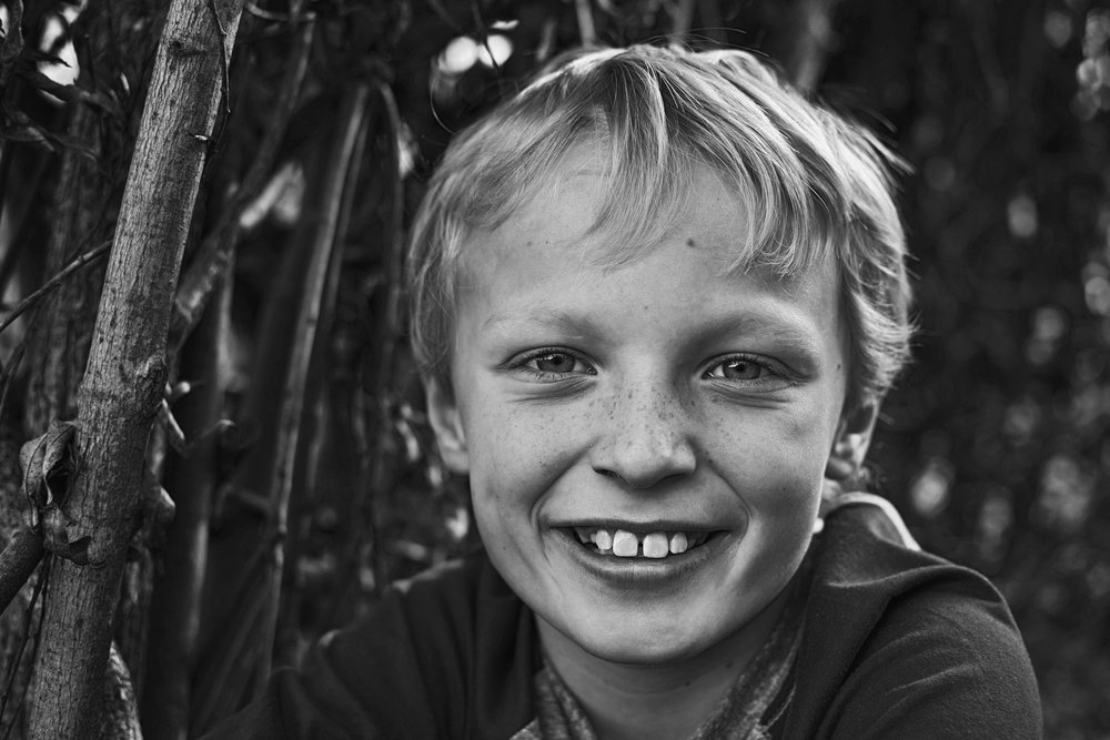 I love with older boys are will to smile for the camera during their portrait sessions!