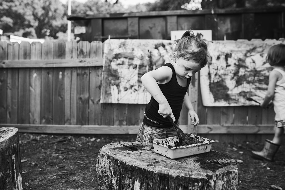 Nicoleinbold loves to photograph children making messes which includes little artist nature painting in their backyards with mud!