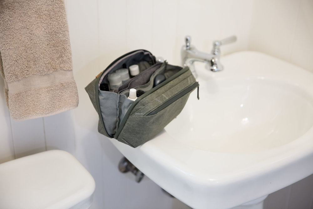 The Wash Pouch can stand on its own, unlike the ones from MUJI