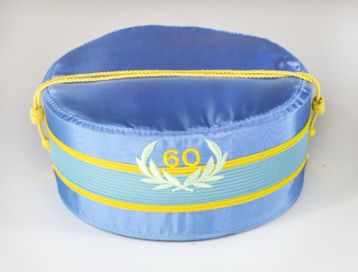 The light blue cap denotes that the wearer has been a Scottish Rite Mason for 50 years or longer, a true distinction in our fraternity!