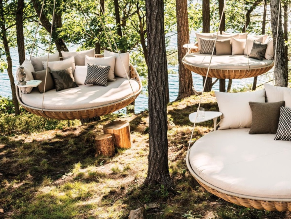 These  Dedon  swinging chairs hung outside have a corner market on fabulous.