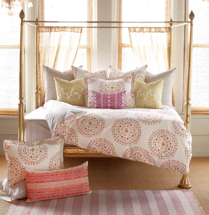 Bedding and pillows by John Robshaw can always fit the bill--foolproof mixing and matching.