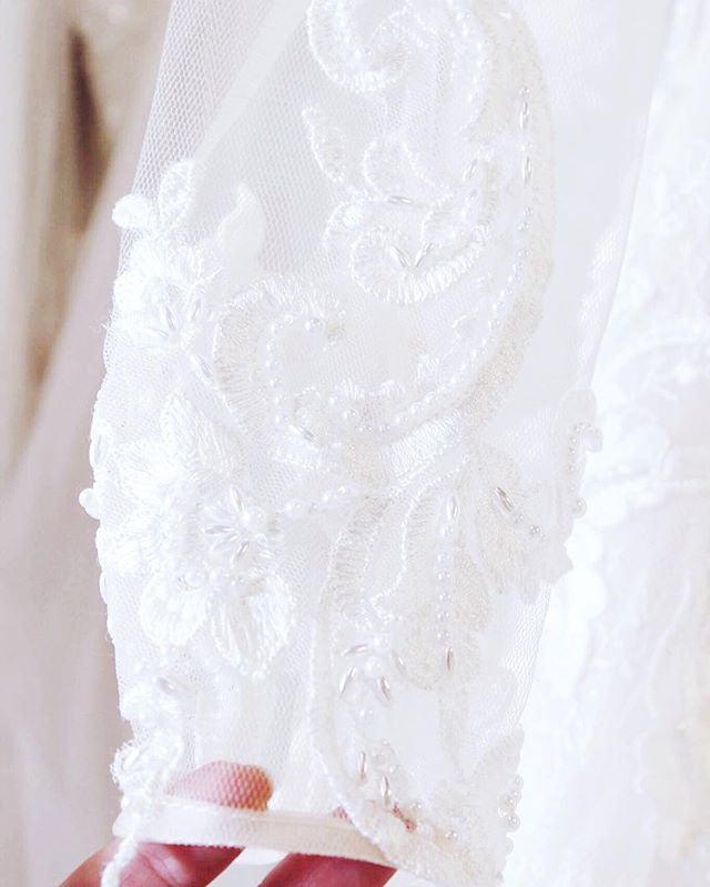 Just one of the details we love about this gorgeous gown with the most lovely lace and beaded detailed sleeves! After you are done swooning you can hop over to our website to make your appointment! We can't wait to help you find #yourperfectsilhouette! #silhouettebridal #itsallinthedetails