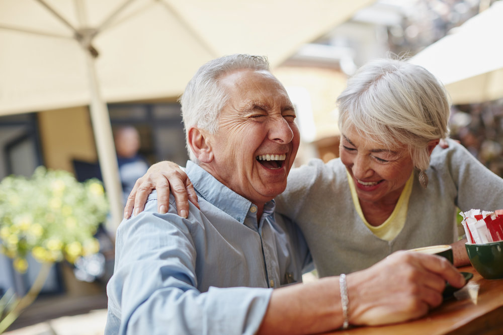 OlderCoupleLaughing_HearingRestoration.jpg