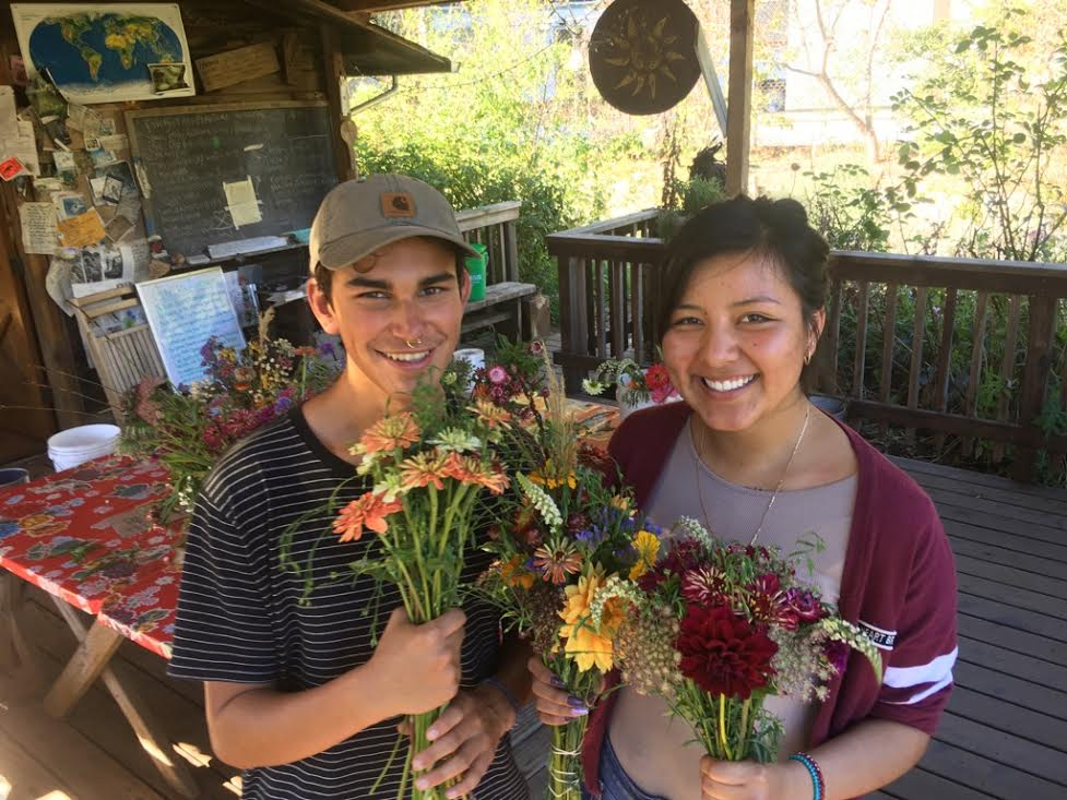 Mason and Mayra run the Tuesday flower bouquet business harvesting flowers they've been growing all season, making beautiful arrangements, delivering them to local businesses, and then taking lead on all accounting.