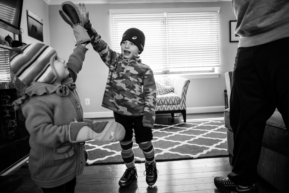 sibling high five, family documentary and lifestyle photography