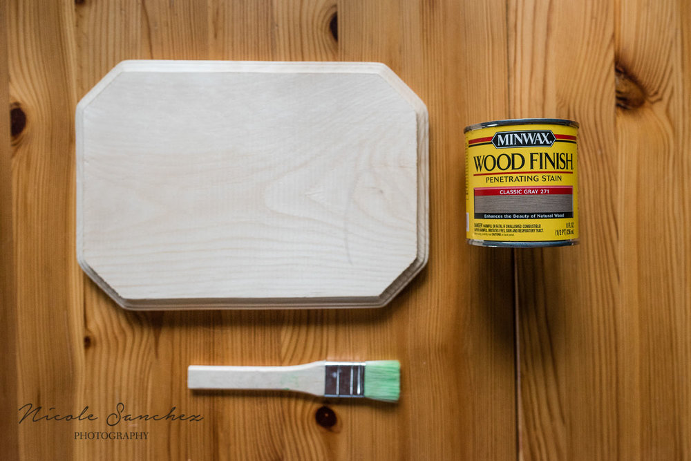 Unfinished wood plaque with can of stain and paintbrush | Alexandria VA family photographer