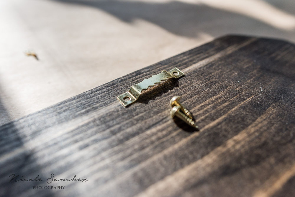 ttaching sawtooth picture hanger | northern va lifestyle family photographer