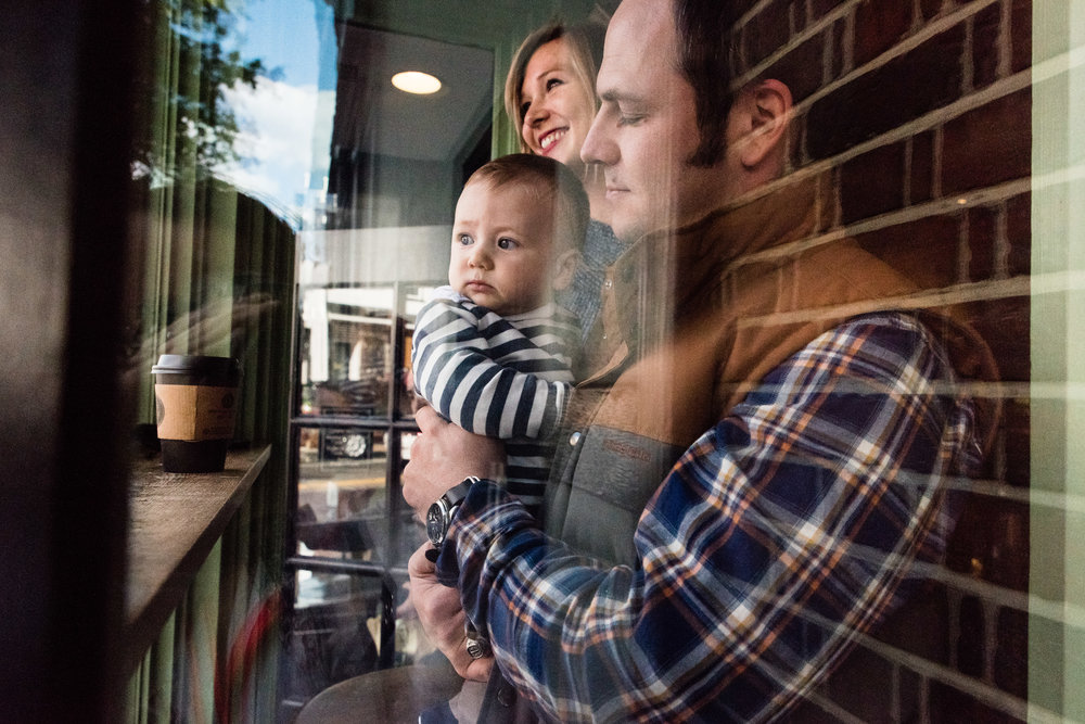 Family in window of coffee shop in Georgetown, D.C. | Washington, D.C. Family Photographer