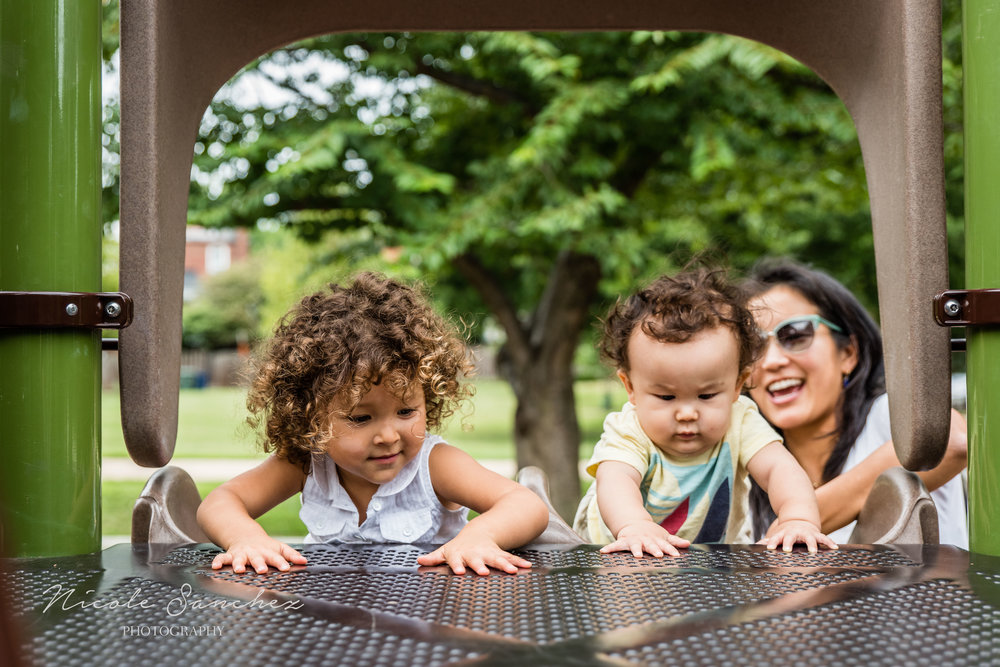 Toddler and baby climbing slide with mom | Old Town Alexandria, VA Family Photographer