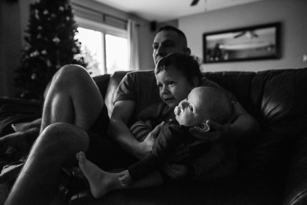 two boys and father in Alexandria, VA by family photographer Nicole Sanchez