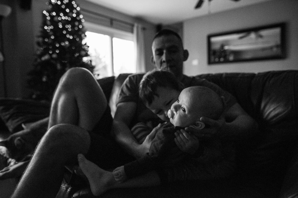 dad holding sons in Northern Virginia by family photographer Nicole Sanchez