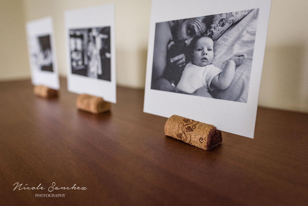 Close-up of cork photo stand by Northern Virginia Family Photographer Nicole Sanchez