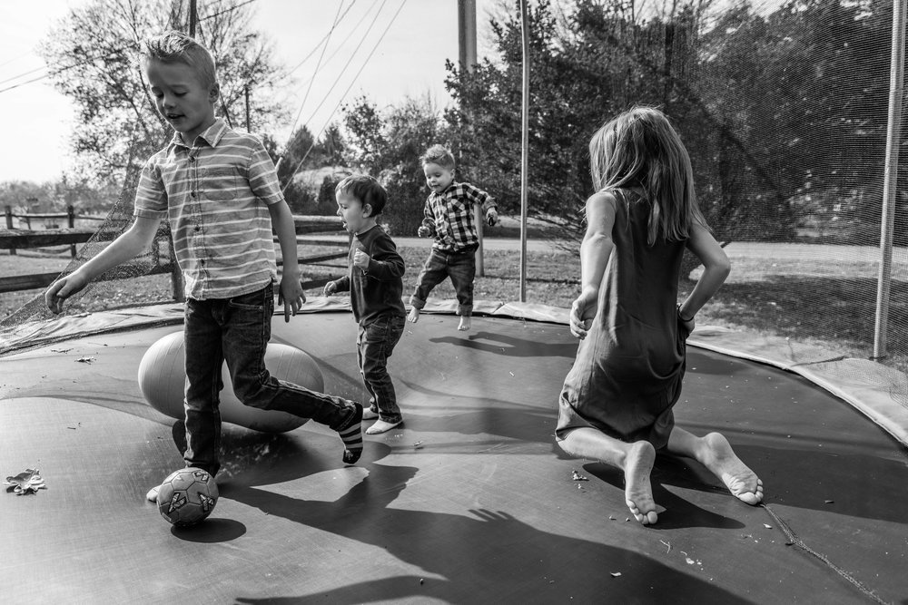 Kids playing on trampoline by Northern Virginia Family Photographer